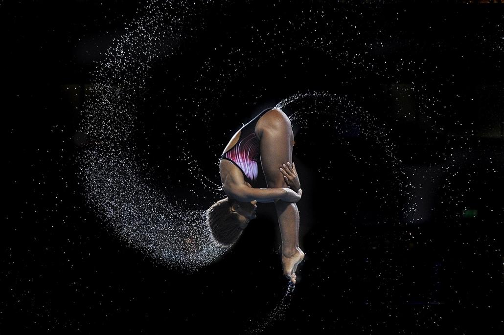 afp. az év sportfotói 2014. Edinburgh, Egyesült Királyság, 2014.08.01. Jennifer Abel of Canada competes to win the gold medal in the Women's 1m Springboard final diving competition at the Royal Commonwealth Pool during the 2014 Commonwealth Games in Edinb