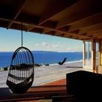 Lélegzetelállító panoráma az óceánra - egy Új-zélandi dobozház