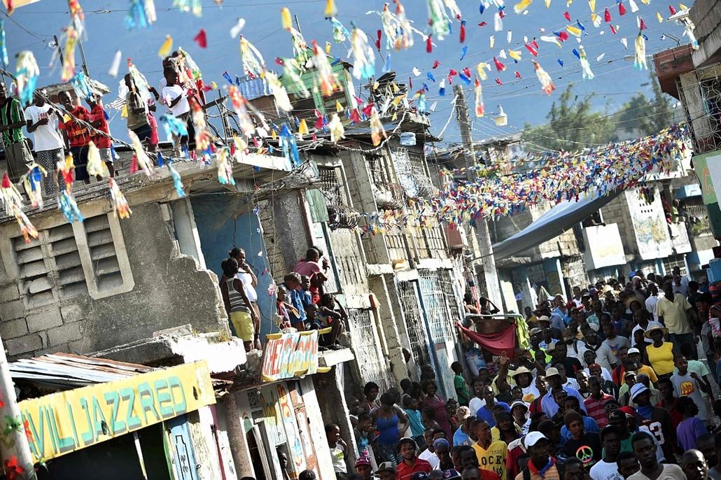 afp. hét képei - 2016.01.25. Haiti, Port-au-Prince, tüntetők az elnök lemondását követelik, Demonstrators are demanding the resignation of Haitian President, Michel Martelly and seek a transitional government. Haiti's electoral authority postponed the pla