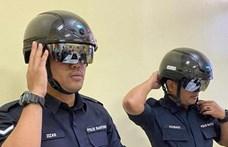 Robotzsarut csináltak a maláj vasúti dolgozókból, sisakkal nézik az utasok testhőmérsékletét